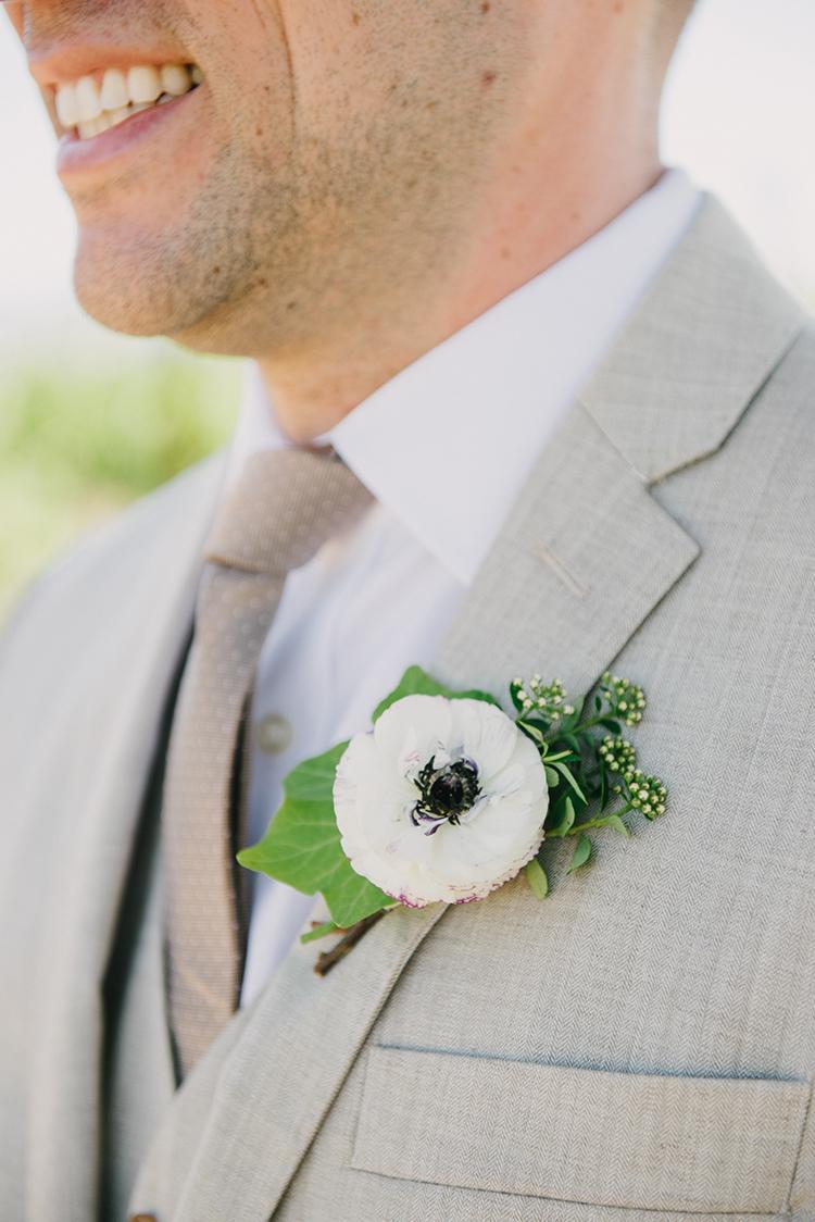anemone boutonnieres - photo by Fondly Forever Photography https://ruffledblog.com/utterly-dreamy-destination-wedding-in-santa-ynez-valley