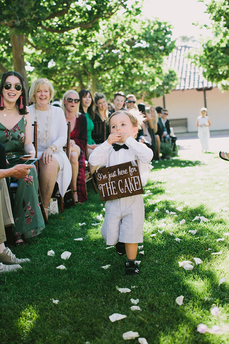 ring bearer signs - photo by Fondly Forever Photography http://ruffledblog.com/utterly-dreamy-destination-wedding-in-santa-ynez-valley