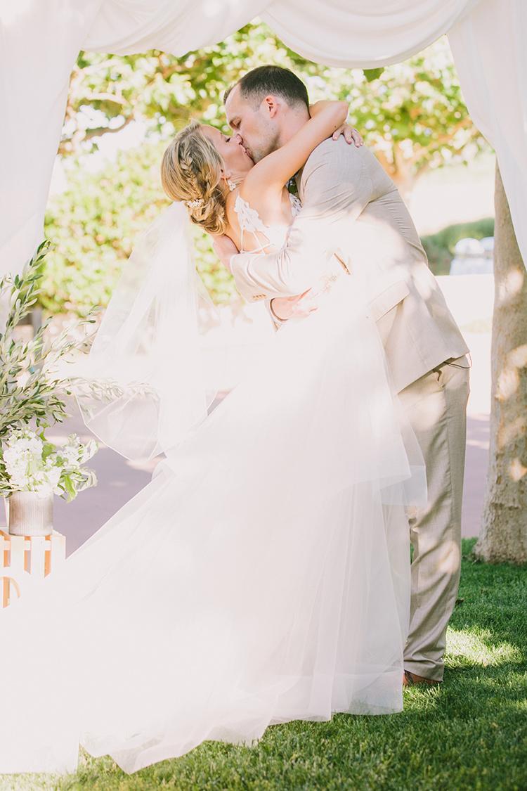 ceremony kiss - photo by Fondly Forever Photography https://ruffledblog.com/utterly-dreamy-destination-wedding-in-santa-ynez-valley