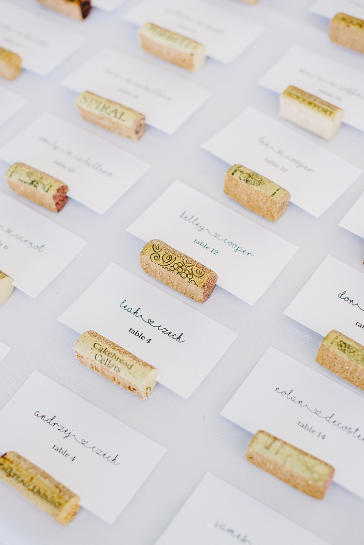 seating charts with wine corks - photo by Fondly Forever Photography https://ruffledblog.com/utterly-dreamy-destination-wedding-in-santa-ynez-valley