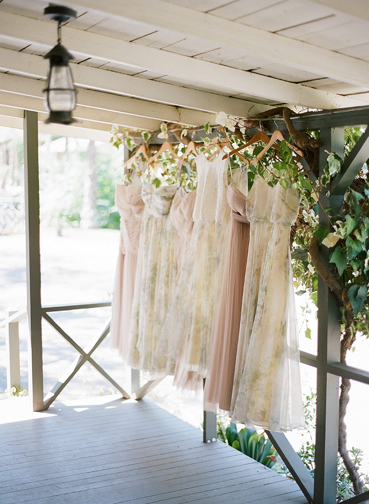 mismatched bridesmaid dresses - photo by Erica Schneider Photography http://ruffledblog.com/vegetable-garden-inspired-wedding-with-seriously-lush-details