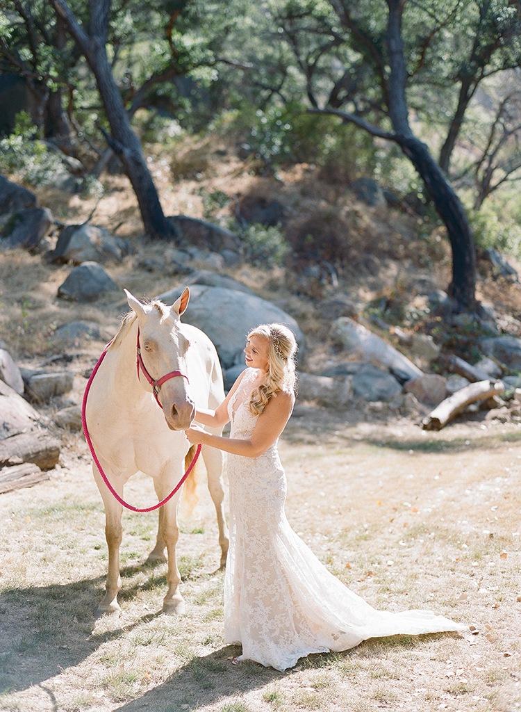 brides with horses - photo by Erica Schneider Photography https://ruffledblog.com/vegetable-garden-inspired-wedding-with-seriously-lush-details