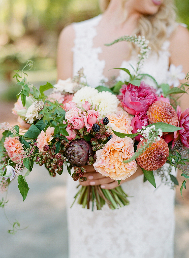 lush bouquets with pink and peach - photo by Erica Schneider Photography https://ruffledblog.com/vegetable-garden-inspired-wedding-with-seriously-lush-details