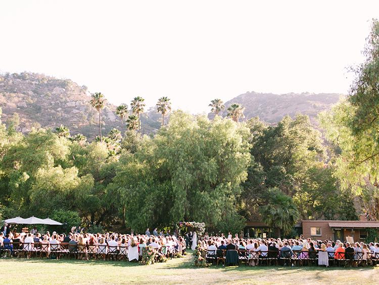 outdoor wedding ceremonies - photo by Erica Schneider Photography http://ruffledblog.com/vegetable-garden-inspired-wedding-with-seriously-lush-details