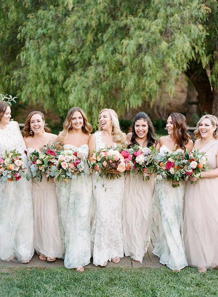 fun mismatched bridesmaid dresses - photo by Erica Schneider Photography http://ruffledblog.com/vegetable-garden-inspired-wedding-with-seriously-lush-details