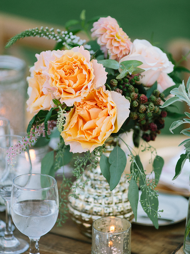 wedding centerpieces with peach flowers - photo by Erica Schneider Photography https://ruffledblog.com/vegetable-garden-inspired-wedding-with-seriously-lush-details