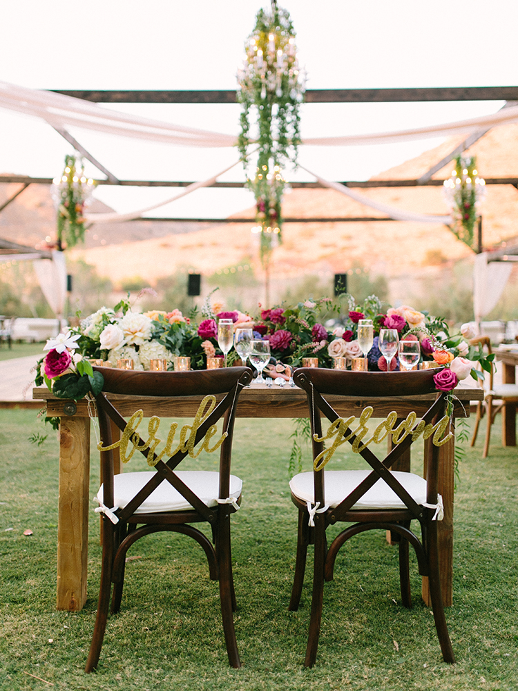 sweetheart tables with signs - photo by Erica Schneider Photography http://ruffledblog.com/vegetable-garden-inspired-wedding-with-seriously-lush-details