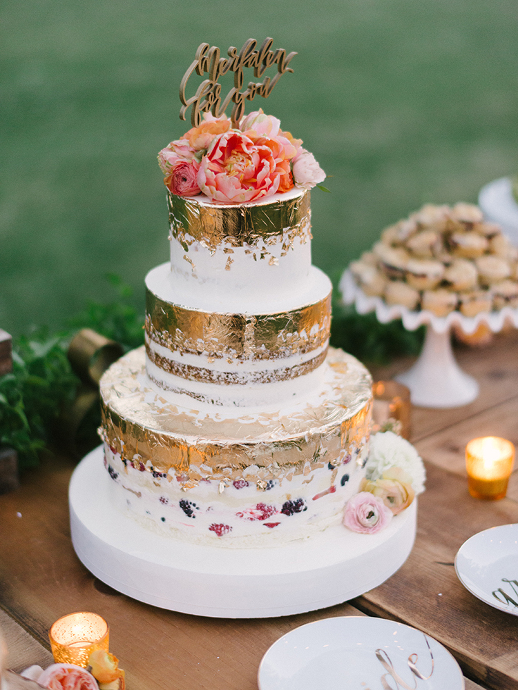 wedding cakes with gold detailing - photo by Erica Schneider Photography https://ruffledblog.com/vegetable-garden-inspired-wedding-with-seriously-lush-details