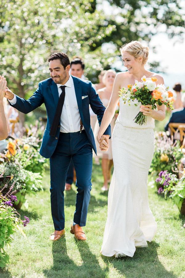 ceremony recessional - photo by Christina Bernales Photography https://ruffledblog.com/vermont-garden-wedding