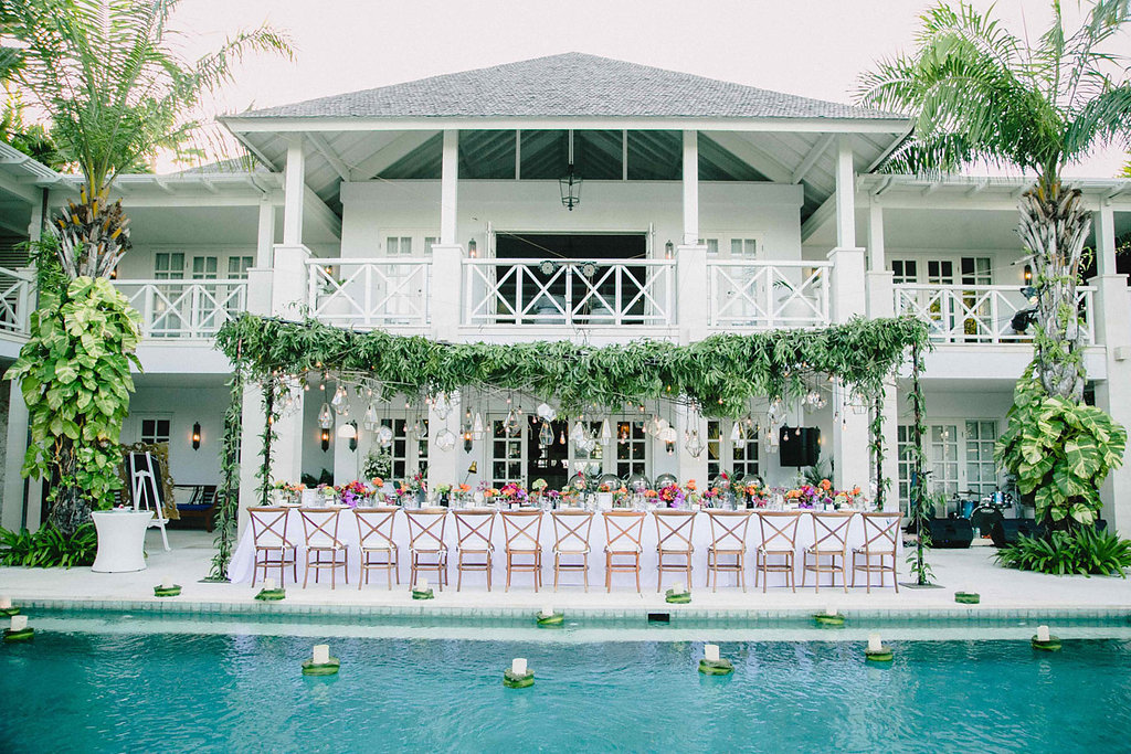 poolside wedding reception - photo by Imaj Gallery https://ruffledblog.com/vibrant-bali-wedding-with-a-hanging-botanical-installation