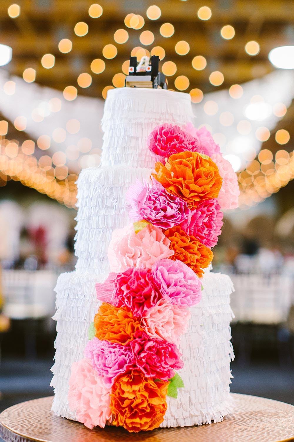 pink and orange carnations ruffled wedding cake