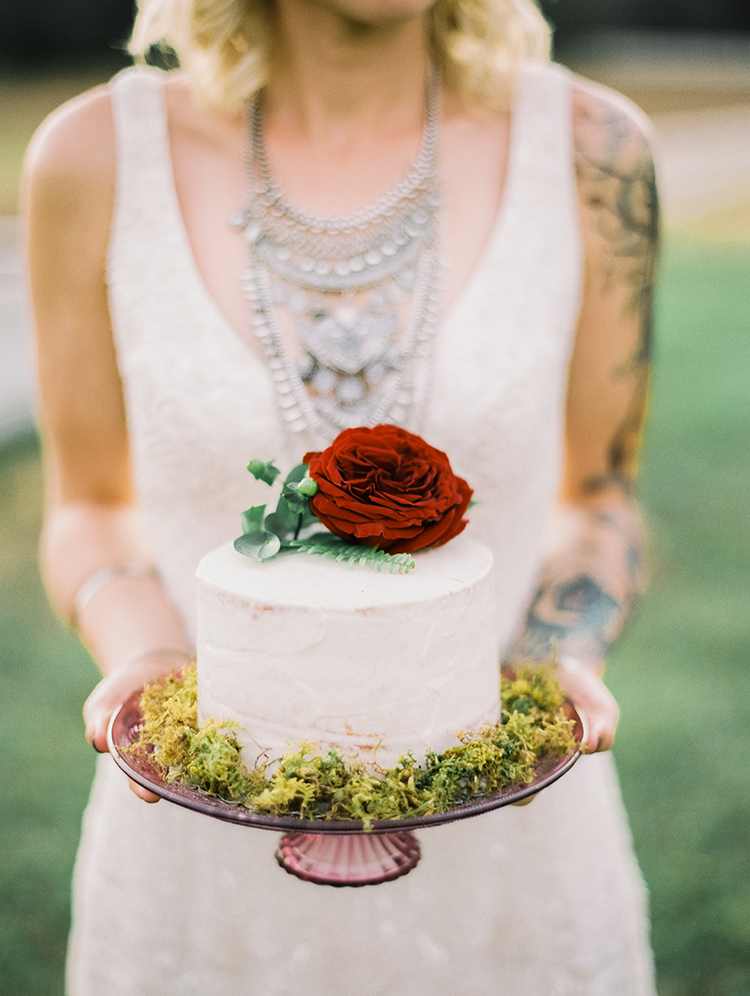 red flower topped cakes - photo by Best Photography http://ruffledblog.com/vibrant-southern-bohemian-wedding-inspiration