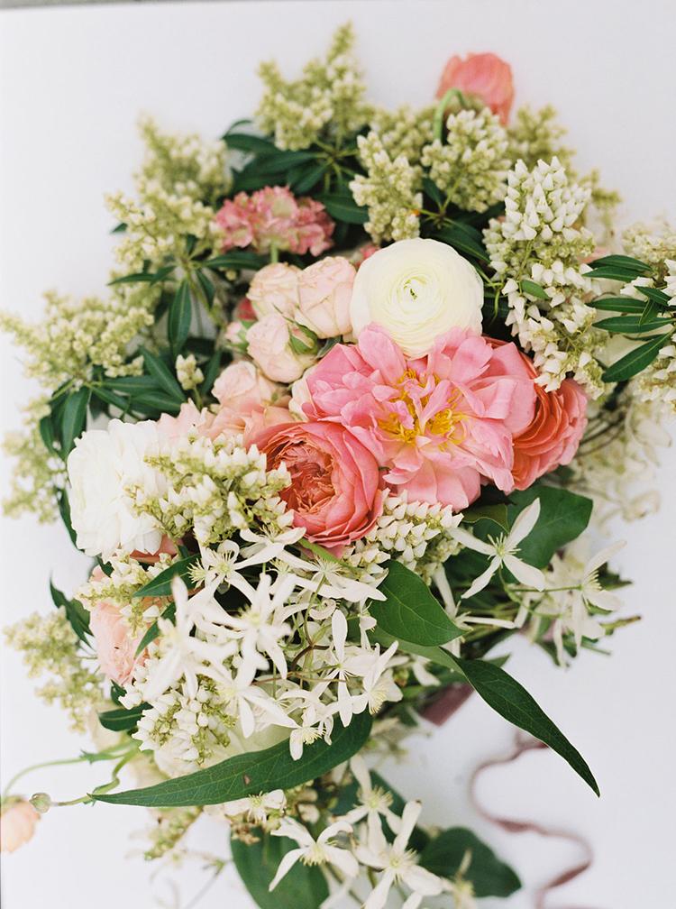 coral charm peony floral arrangements - photo by Ali Mae Photo http://ruffledblog.com/vibrant-summer-wedding-inspiration-with-bridal-fashion