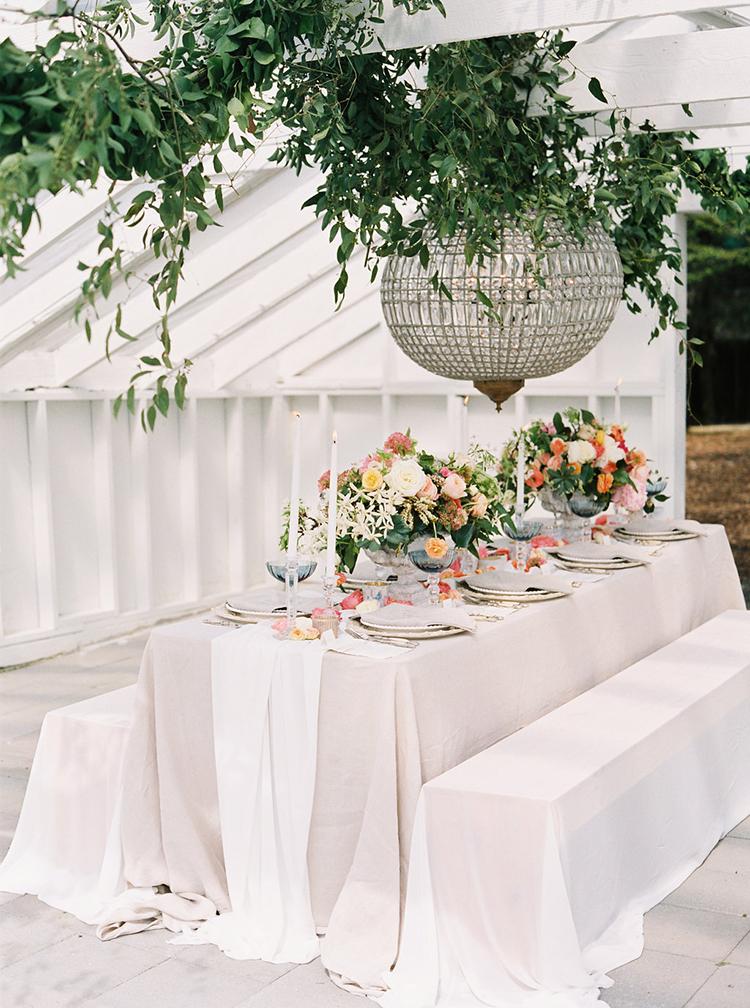 wedding receptions with chandeliers - photo by Ali Mae Photo https://ruffledblog.com/vibrant-summer-wedding-inspiration-with-bridal-fashion