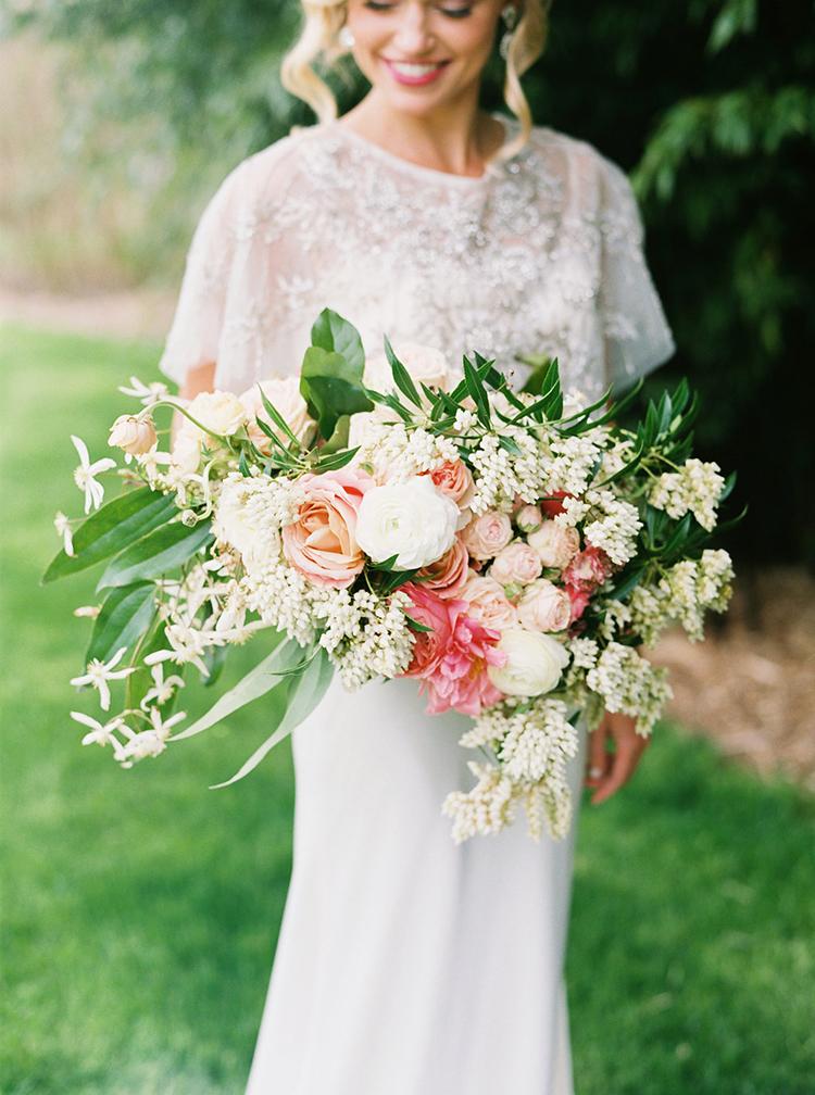 lush summer wedding bouquets - photo by Ali Mae Photo http://ruffledblog.com/vibrant-summer-wedding-inspiration-with-bridal-fashion