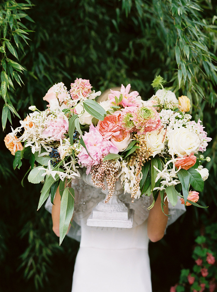wedding flower arrangements - photo by Ali Mae Photo http://ruffledblog.com/vibrant-summer-wedding-inspiration-with-bridal-fashion