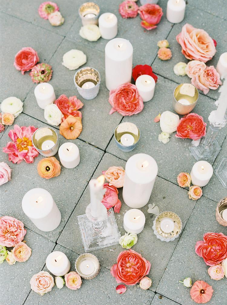 wedding flowers and candles - photo by Ali Mae Photo https://ruffledblog.com/vibrant-summer-wedding-inspiration-with-bridal-fashion