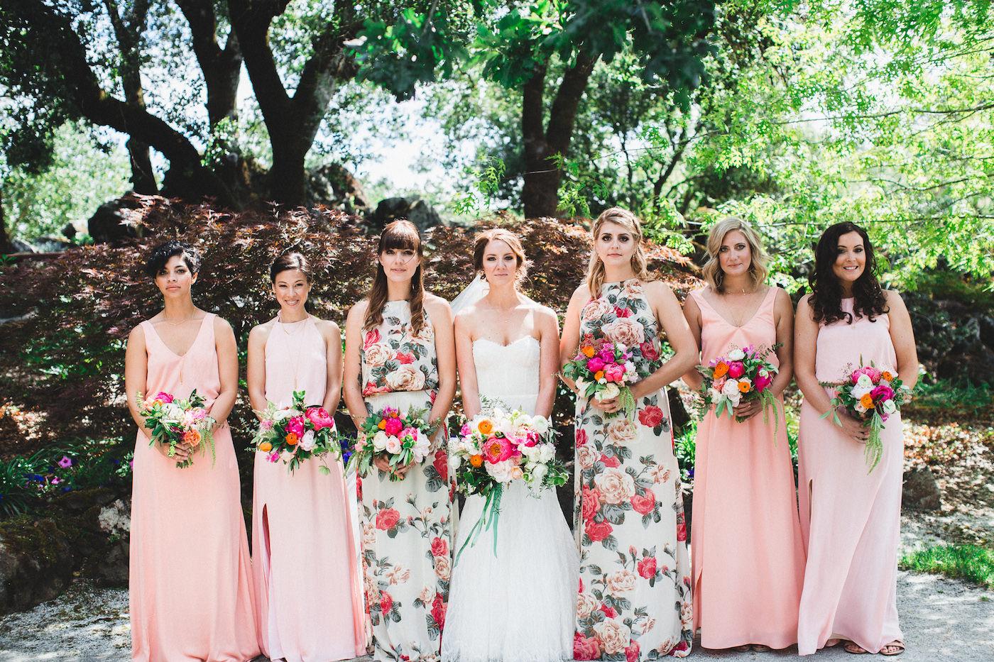floral bridesmaid dresses - photo by Studio Castillero https://ruffledblog.com/vibrant-winery-wedding-in-california