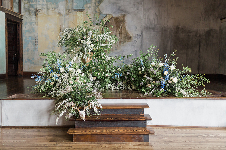 wedding ceremony venues - photo by Chloe Luka Photography https://ruffledblog.com/vintage-bohemia-wedding-ideas-with-statement-floral-arrangements