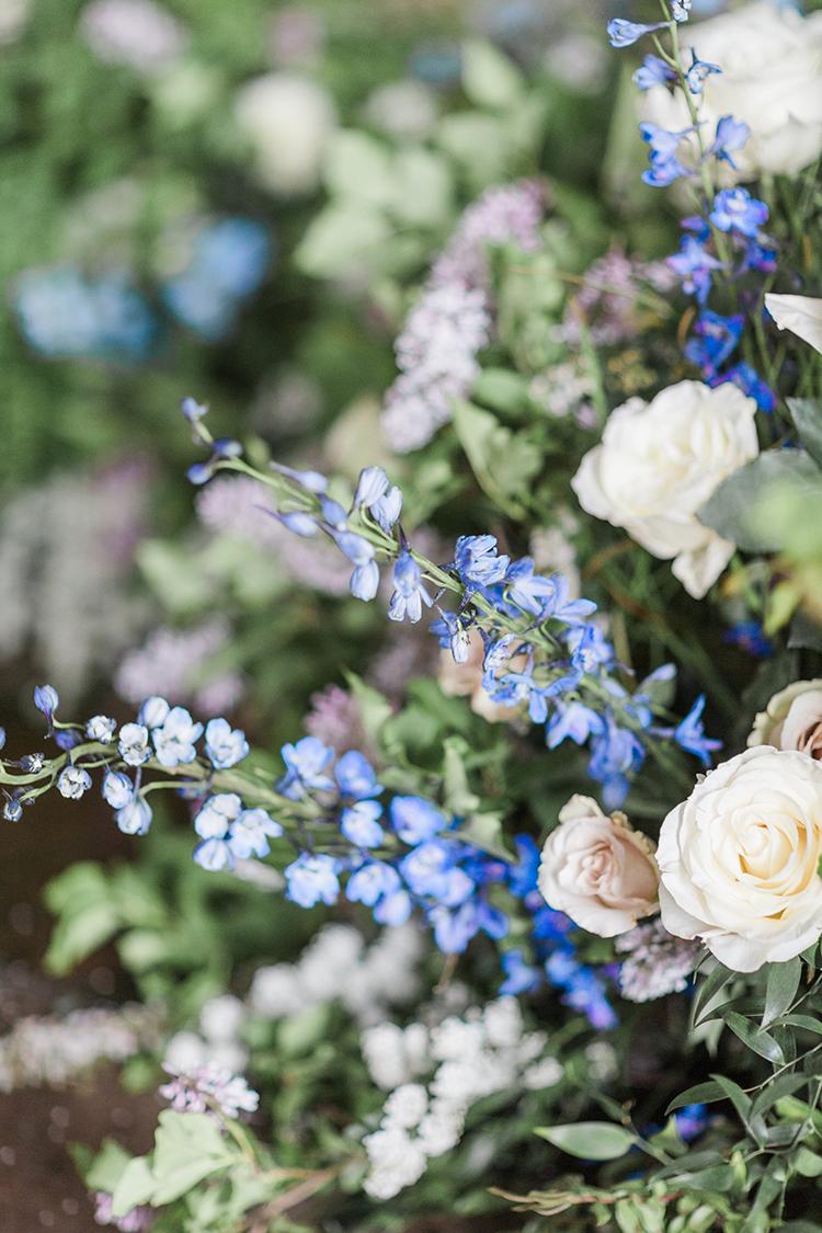 blue wedding flowers - photo by Chloe Luka Photography https://ruffledblog.com/vintage-bohemia-wedding-ideas-with-statement-floral-arrangements