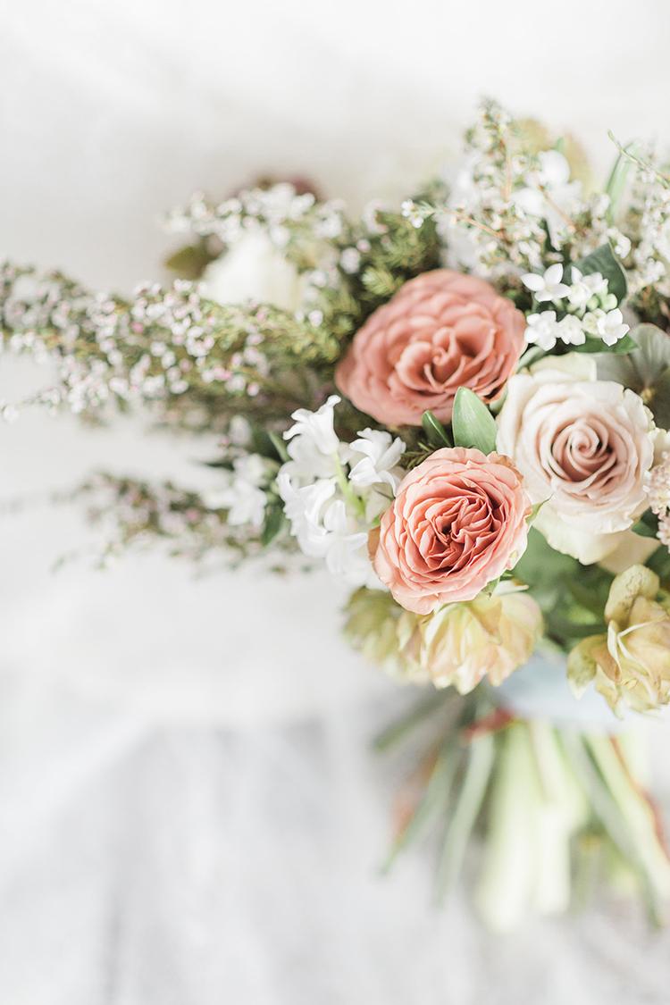 dusty pink bouquet - photo by Chloe Luka Photography https://ruffledblog.com/vintage-bohemia-wedding-ideas-with-statement-floral-arrangements