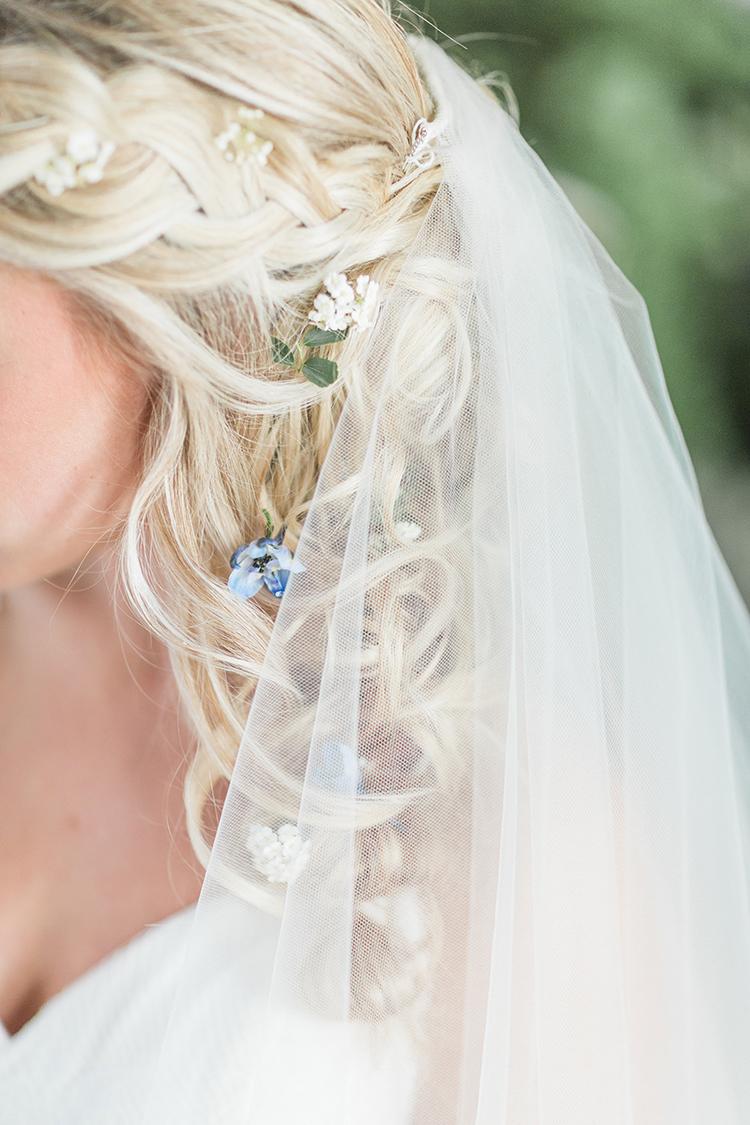 hair flowers - photo by Chloe Luka Photography https://ruffledblog.com/vintage-bohemia-wedding-ideas-with-statement-floral-arrangements