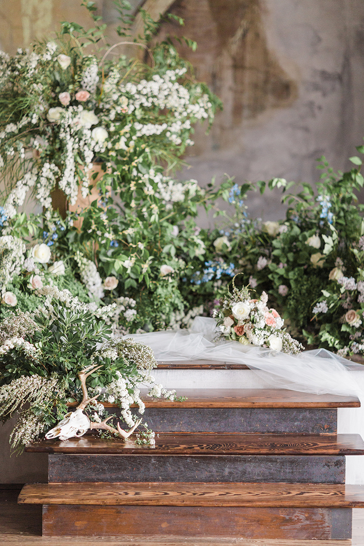 ceremony venues with flowers - photo by Chloe Luka Photography http://ruffledblog.com/vintage-bohemia-wedding-ideas-with-statement-floral-arrangements