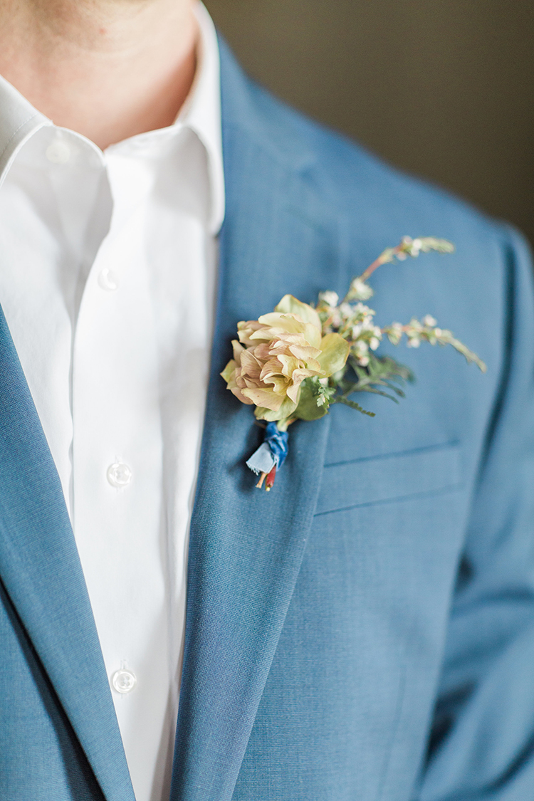 yellow groom boutonnieres - photo by Chloe Luka Photography https://ruffledblog.com/vintage-bohemia-wedding-ideas-with-statement-floral-arrangements