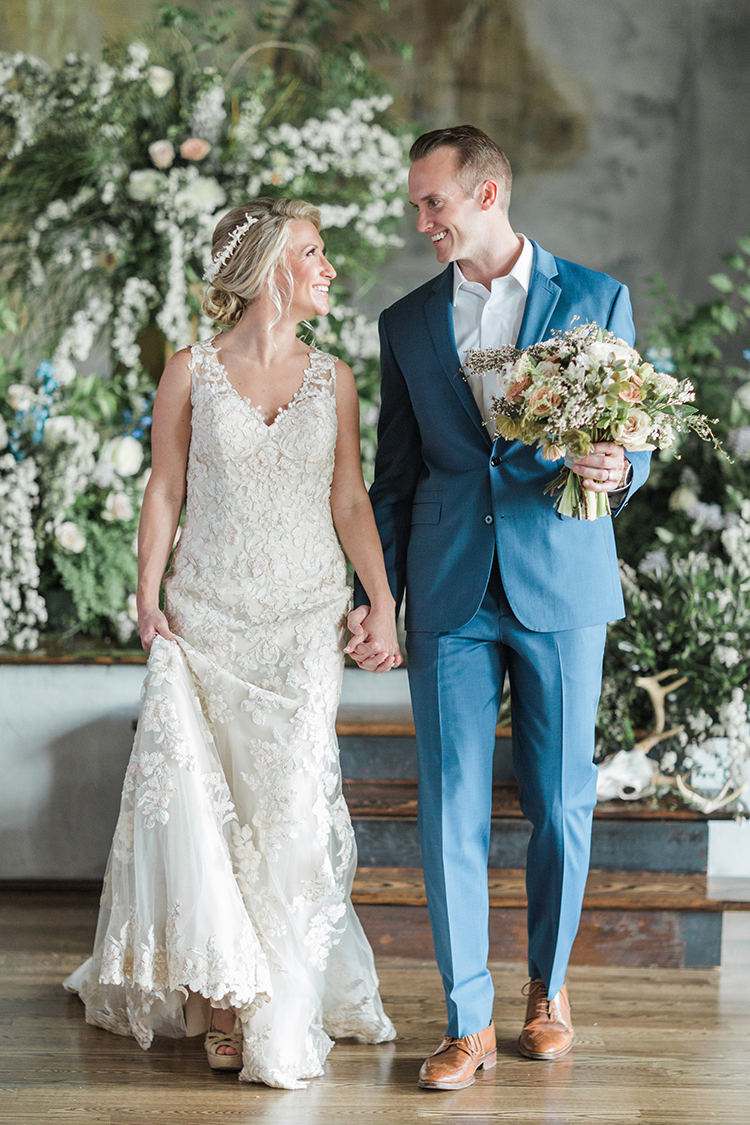 bride and groom - photo by Chloe Luka Photography https://ruffledblog.com/vintage-bohemia-wedding-ideas-with-statement-floral-arrangements