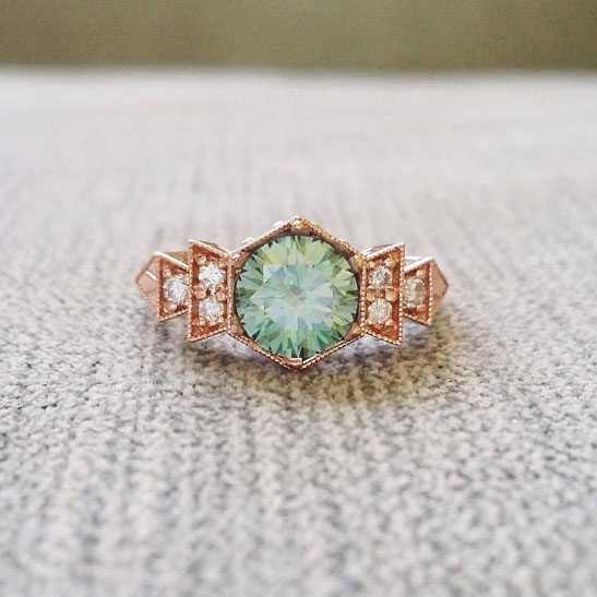 stunning aqua mint and gold ring #weddingrings #engagementrings #vintagerings  https://ruffledblog.com/romantic-vintage-engagement-rings/
