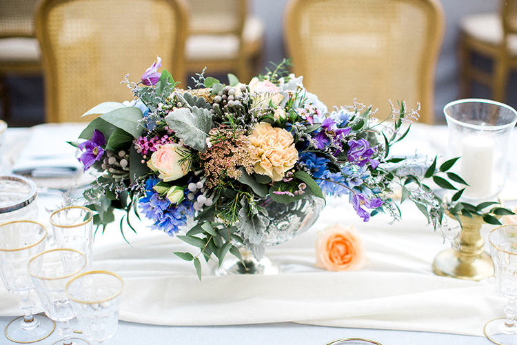 purple centerpieces - photo by Booth Photographics https://ruffledblog.com/watercolor-destination-wedding-in-florence
