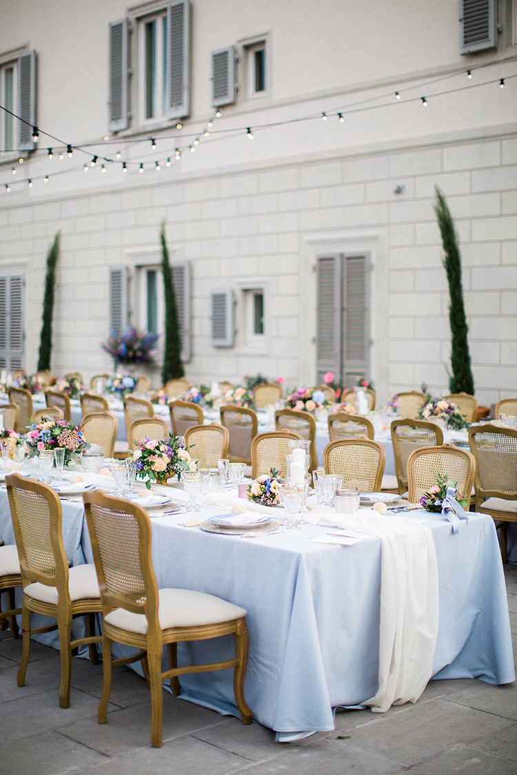 blue wedding tablecloths - photo by Booth Photographics http://ruffledblog.com/watercolor-destination-wedding-in-florence