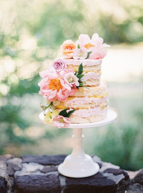 floral naked wedding cake - photo by Jessica Gold Photography https://ruffledblog.com/watercolor-garden-wedding-inspiration
