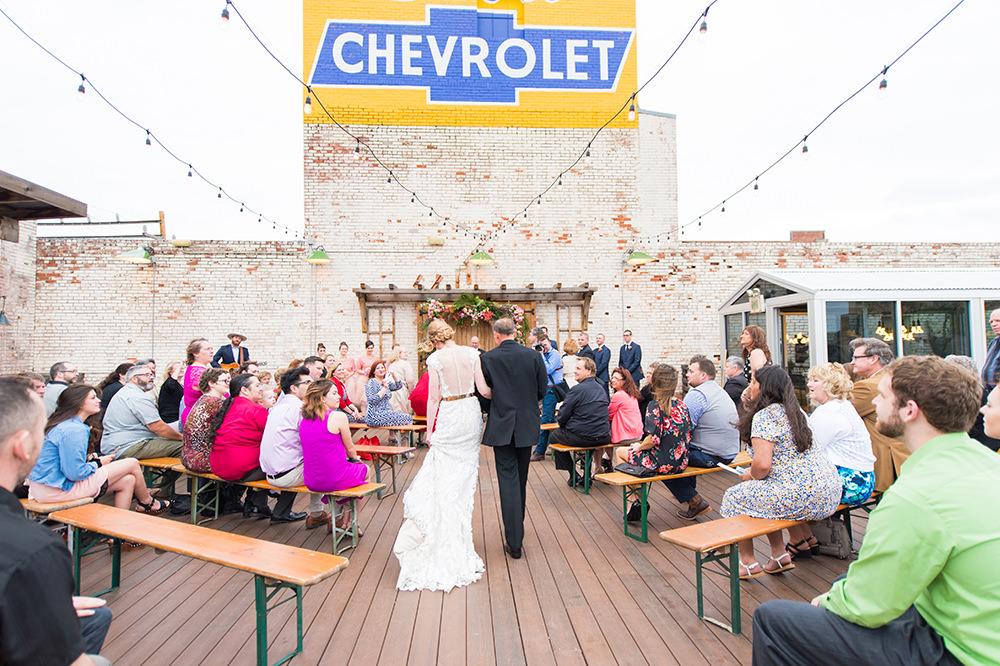 wedding ceremony - photo by Ely Fair Photography https://ruffledblog.com/whimsical-oklahoma-city-wedding