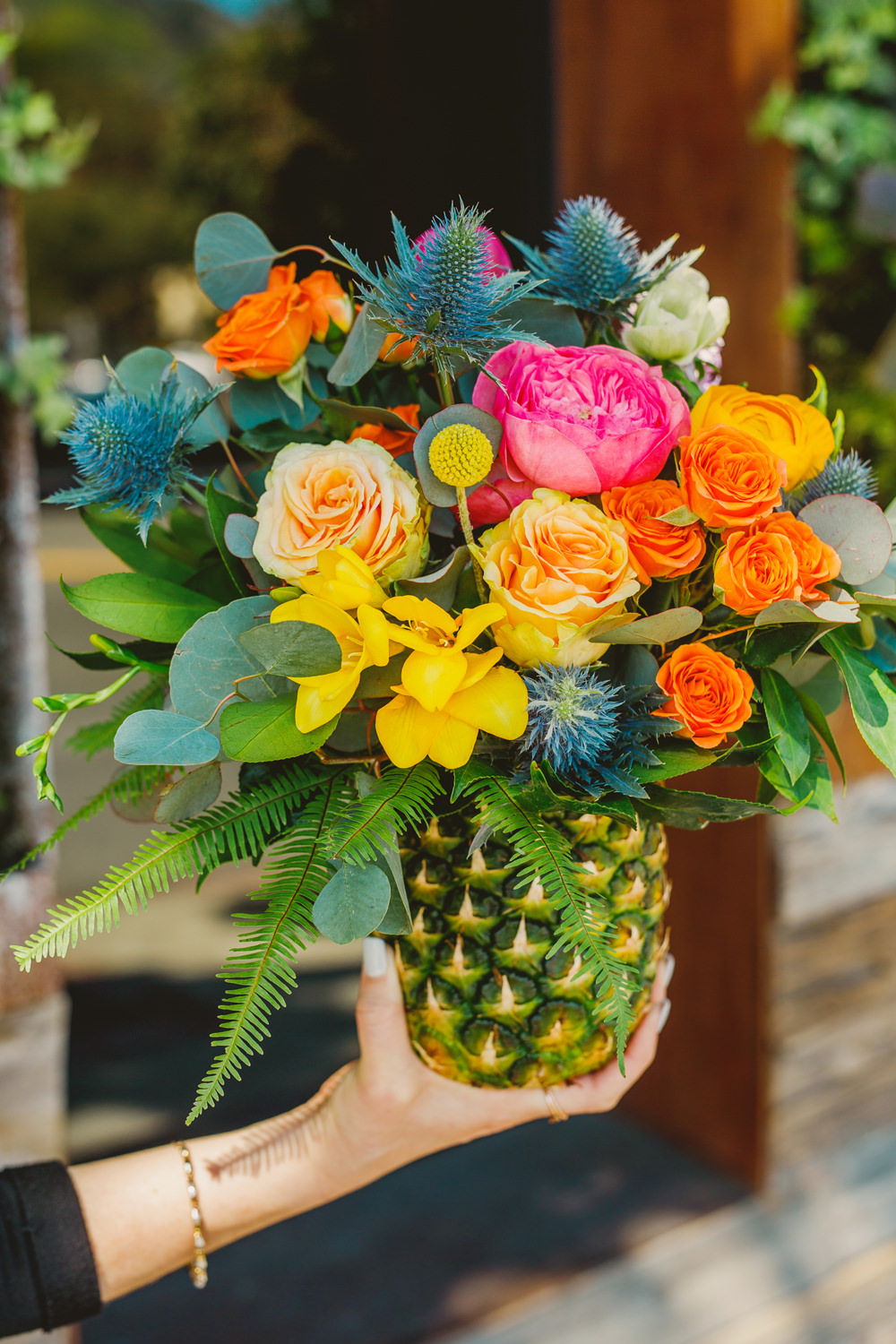 wedding flower displays - photo by Priscila Valentina http://ruffledblog.com/whimsical-vibrant-laguna-beach-wedding