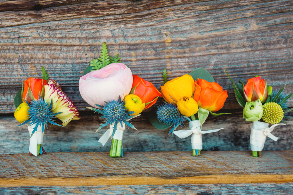 groom boutonnieres - photo by Priscila Valentina http://ruffledblog.com/whimsical-vibrant-laguna-beach-wedding