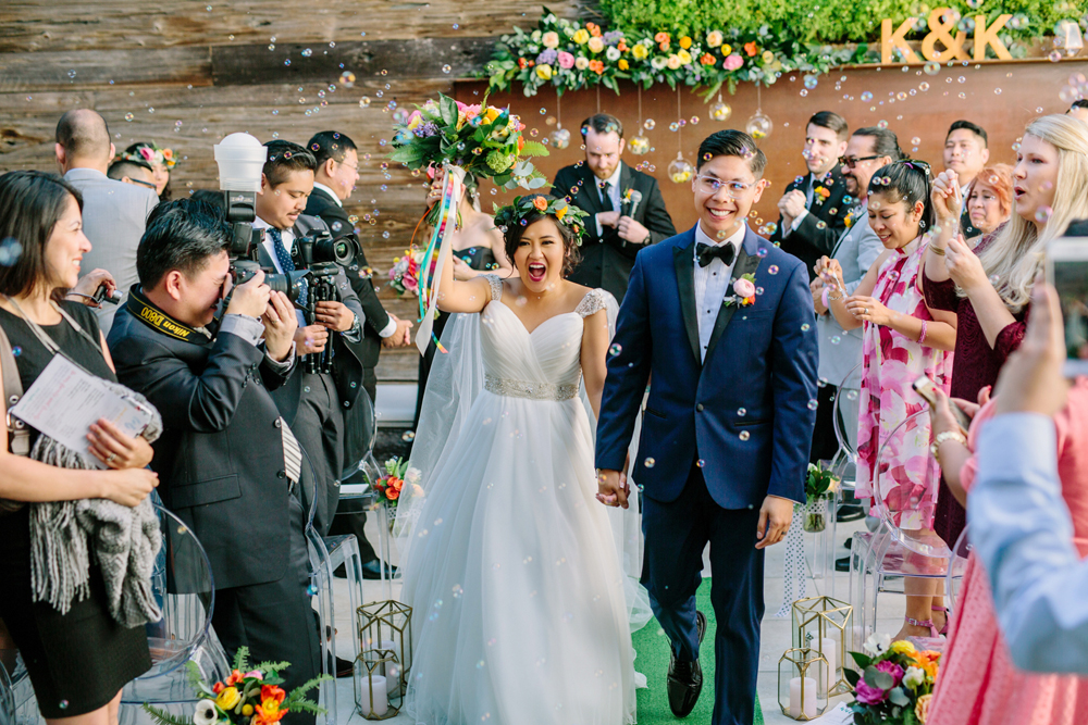 ceremony recessionals - photo by Priscila Valentina https://ruffledblog.com/whimsical-vibrant-laguna-beach-wedding