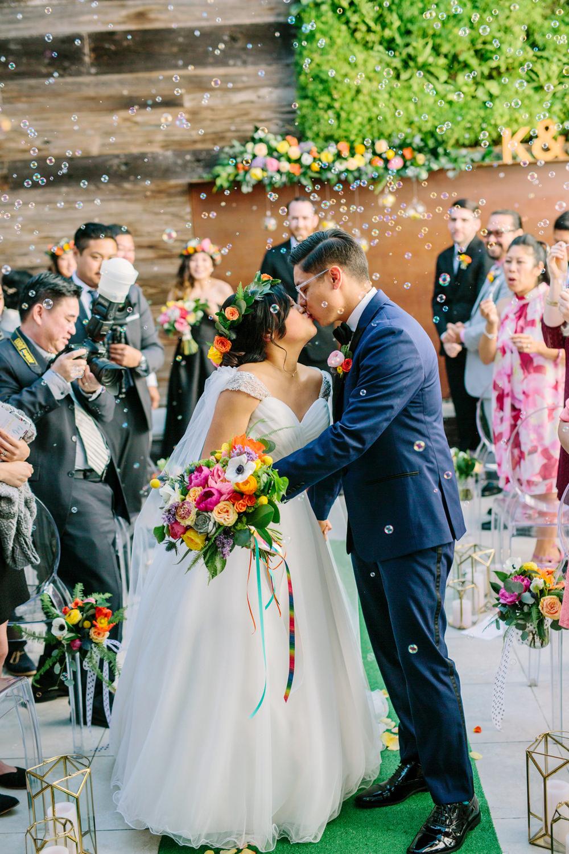 bubbles instead of rice toss - photo by Priscila Valentina https://ruffledblog.com/whimsical-vibrant-laguna-beach-wedding
