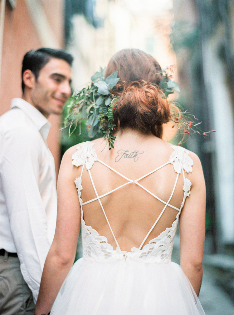 wedding dress straps - photo by Wild Beach Elopement Inspiration at Cinque Terre http://ruffledblog.com/wild-beach-elopement-inspiration-in-cinque-terre