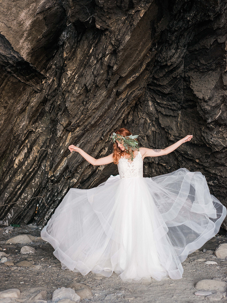 wedding dress photography - photo by Wild Beach Elopement Inspiration at Cinque Terre https://ruffledblog.com/wild-beach-elopement-inspiration-in-cinque-terre