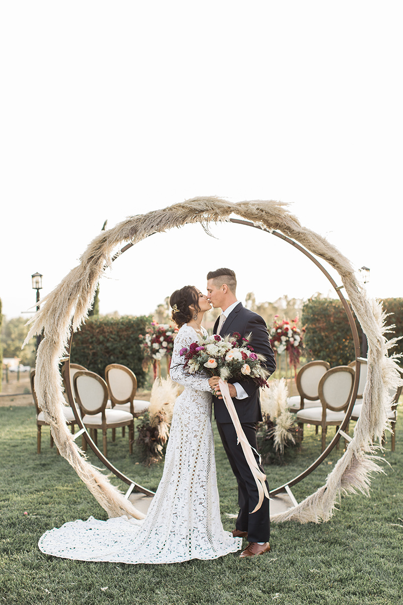 Wine Country Wedding Inspiration with a Pampas Grass Arch - https://ruffledblog.com/wine-country-wedding-inspiration-with-a-pampas-grass-arch