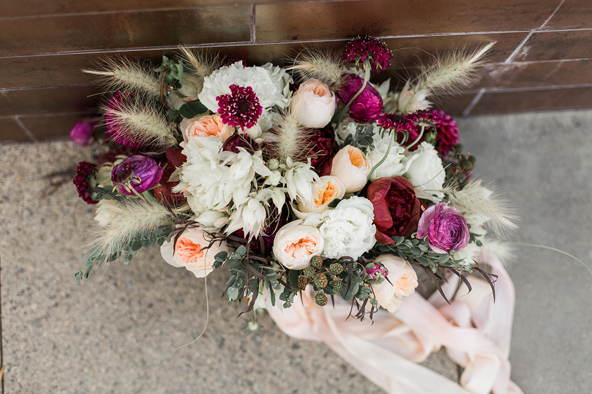 wedding bouquets with fuchsia - https://ruffledblog.com/wine-country-wedding-inspiration-with-a-pampas-grass-arch