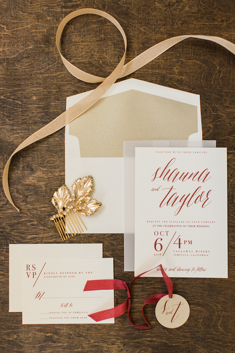 neutral colored wedding invitations - https://ruffledblog.com/wine-country-wedding-inspiration-with-a-pampas-grass-arch