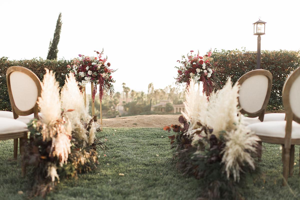 pampas grass wedding inspiration - https://ruffledblog.com/wine-country-wedding-inspiration-with-a-pampas-grass-arch