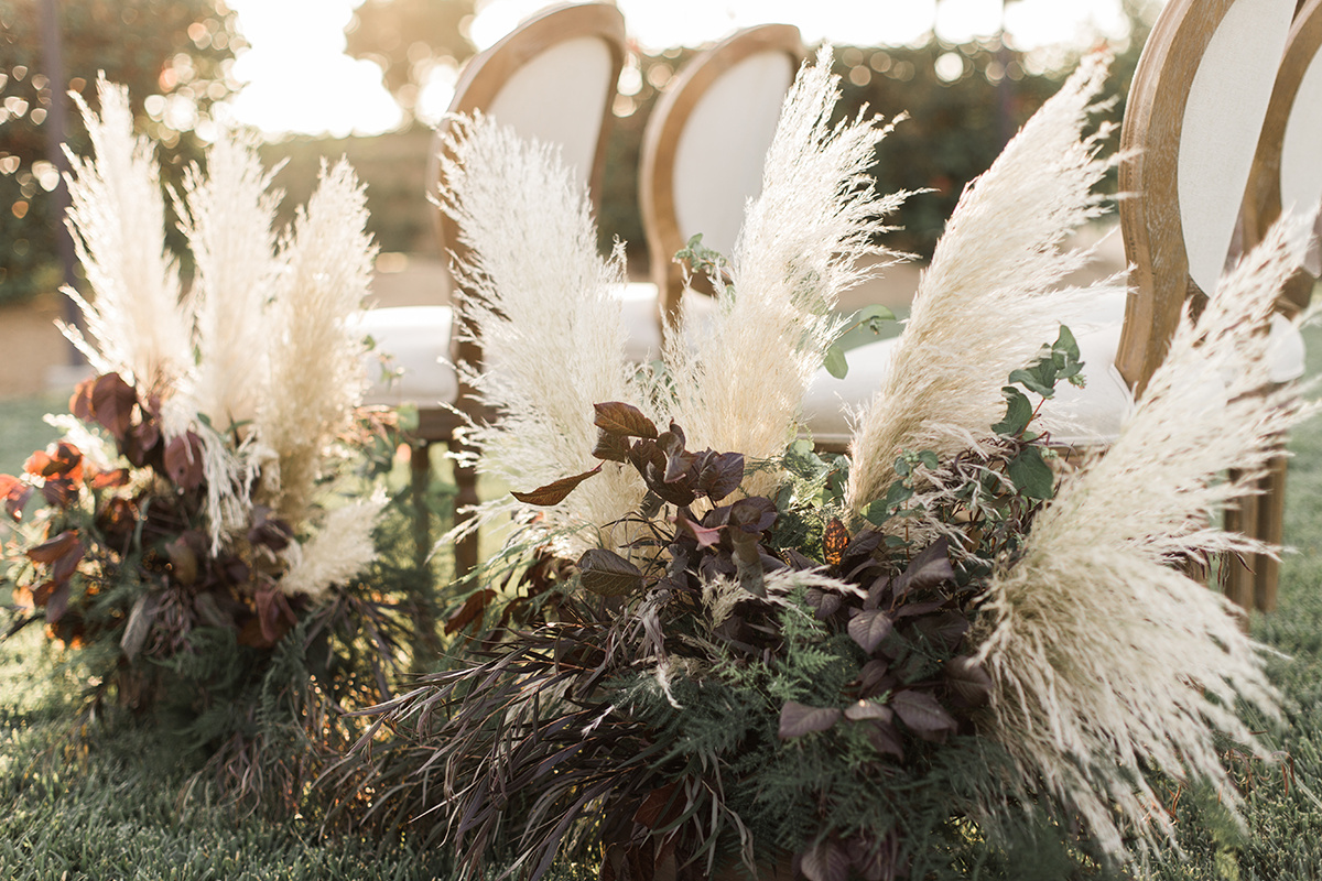 pampas grass used in weddings - https://ruffledblog.com/wine-country-wedding-inspiration-with-a-pampas-grass-arch