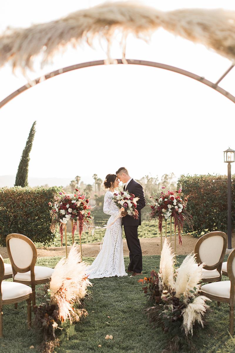 modern winery wedding inspiration - https://ruffledblog.com/wine-country-wedding-inspiration-with-a-pampas-grass-arch