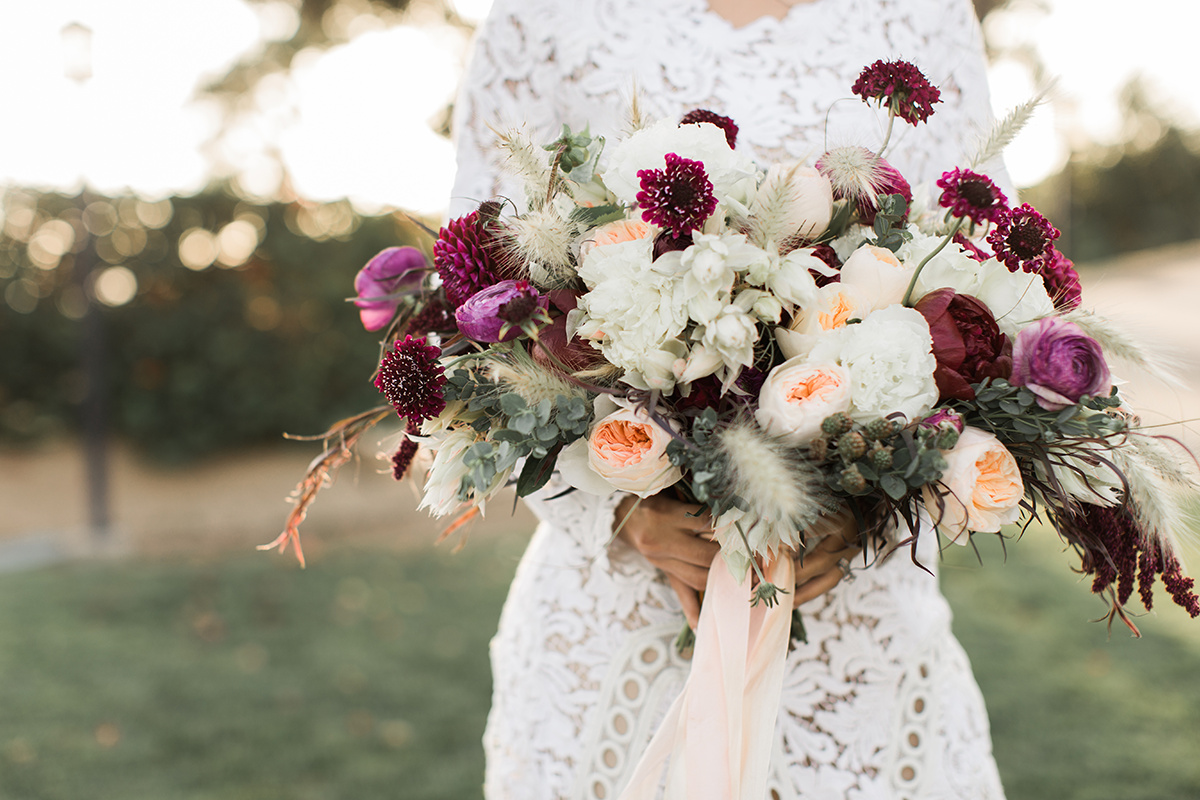 wedding bouquets with burgundy - https://ruffledblog.com/wine-country-wedding-inspiration-with-a-pampas-grass-arch