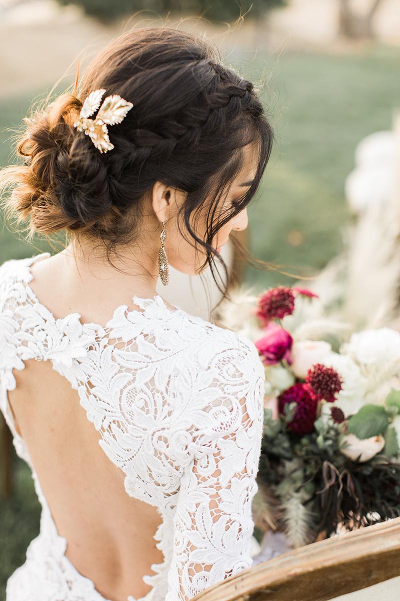 beautiful wedding hair ideas with braids - https://ruffledblog.com/wine-country-wedding-inspiration-with-a-pampas-grass-arch