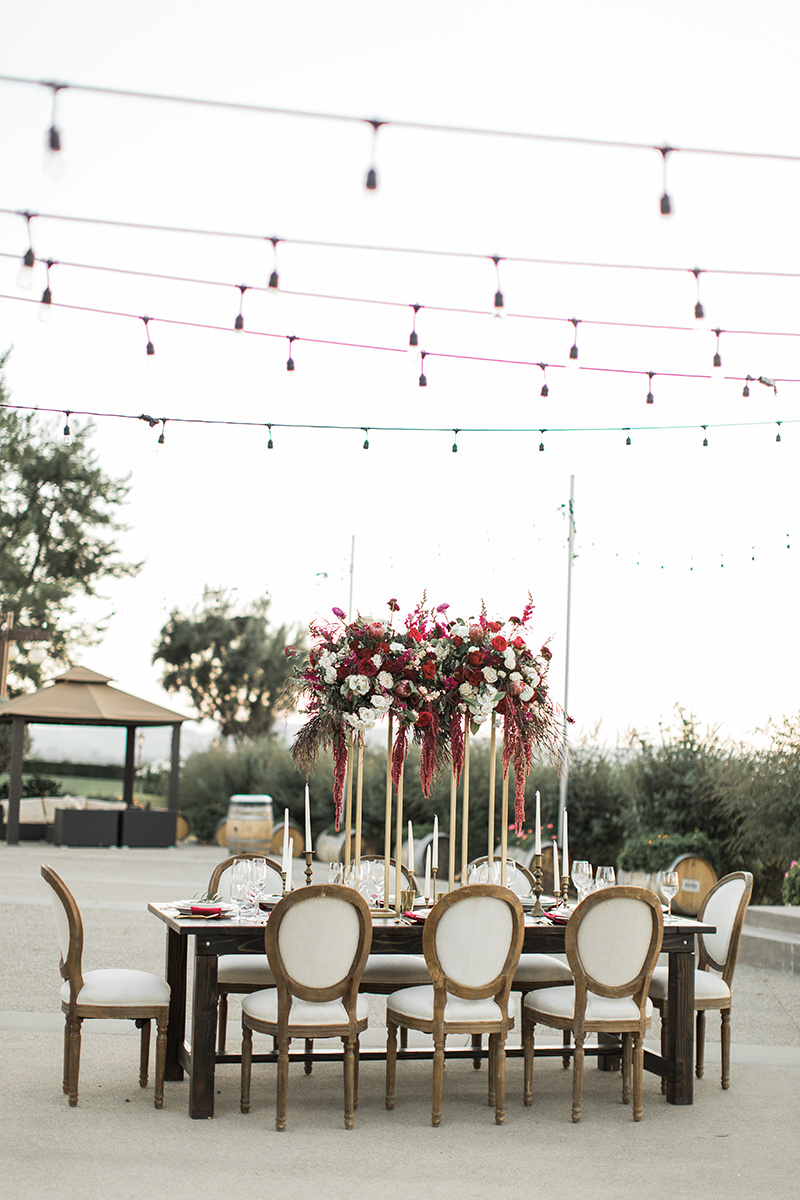 winery wedding inspiration with burgundy - https://ruffledblog.com/wine-country-wedding-inspiration-with-a-pampas-grass-arch