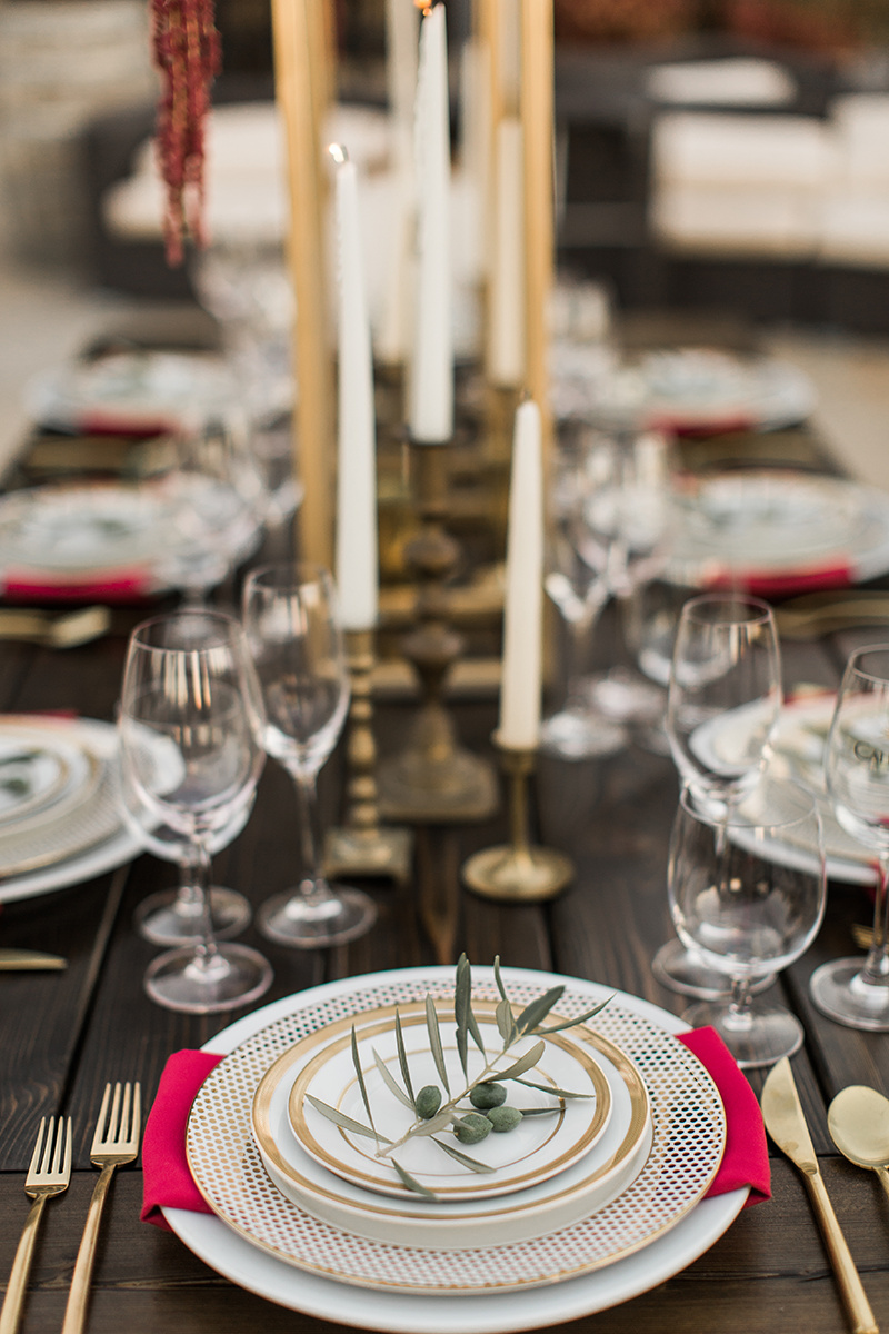 wedding inspiration with olive leaf accents - https://ruffledblog.com/wine-country-wedding-inspiration-with-a-pampas-grass-arch